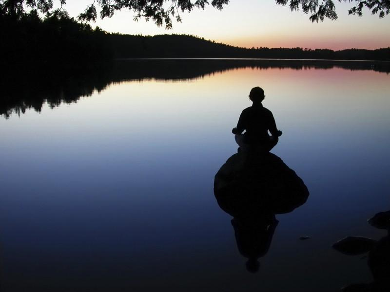 photo of someone meditating that links to Be Well program